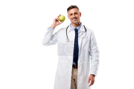 Photo for Smiling doctor holding green apple in hand isolated on white, healthy eating concept - Royalty Free Image
