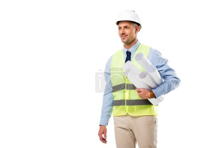smiling engineer holding blueprints and looking away isolated on white