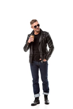 Photo for Stylish adult man in leather jacket with hand in pocket drinking coffee to go isolated on white - Royalty Free Image