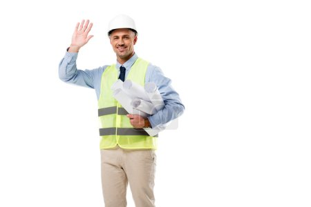 smiling engineer holding blueprints and waving isolated on white