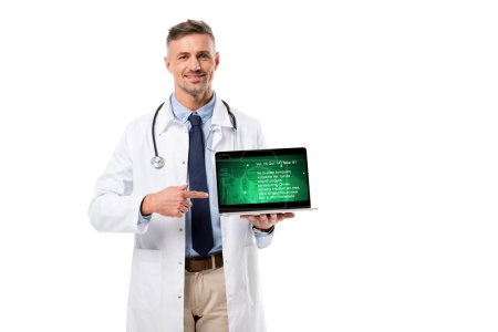 handsome doctor pointing at laptop with health data on screen isolated on white