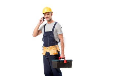 Photo for Construction worker in helmet talking on smartphone isolated on white - Royalty Free Image