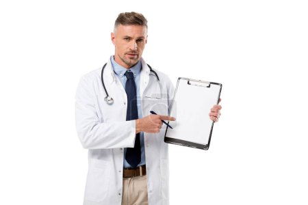 Photo for Serious doctor with pen looking at camera and pointing at diagnosis isolated on white - Royalty Free Image