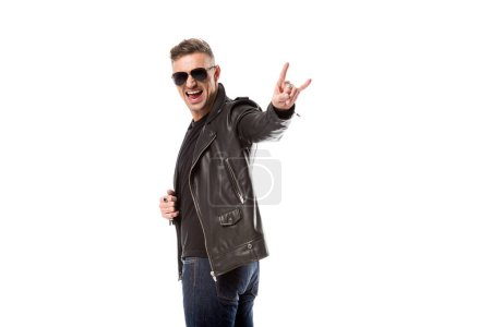 Photo for Excited man in leather jacket and sunglasses showing rock sign isolated on white - Royalty Free Image