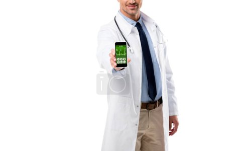 cropped view of doctor holding smartphone with health data app on screen isolated on white