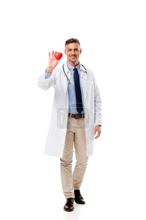 handsome doctor holding heart model in hand isolated on white, heart healthcare concept