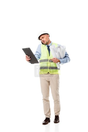 engineer holding blueprints, talking on smartphone and looking at clipboard isolated on white