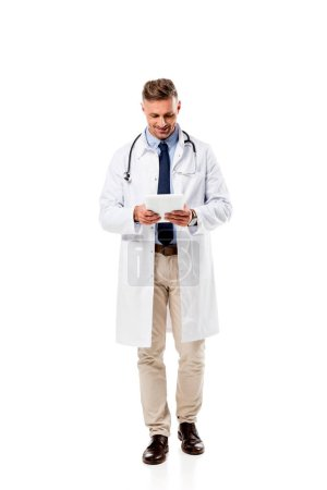 Photo for Smiling doctor using digital tablet isolated on white - Royalty Free Image