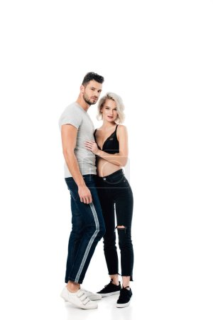 beautiful heterosexual couple hugging and looking at camera isolated on white