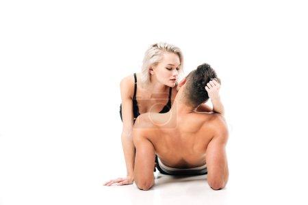 beautiful girlfriend passionately touching boyfriend neck isolated on white