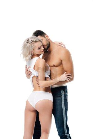 Photo pour Couple hétérosexuel passionné étreinte isolé sur blanc - image libre de droit