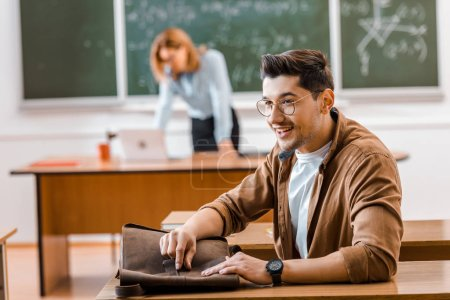 Photo for Selective focus of student in glasses with teacher on background - Royalty Free Image