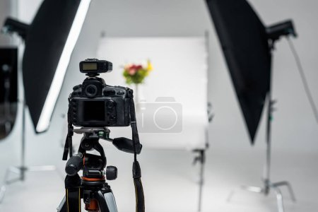 close-up view of professional photo camera in photo studio