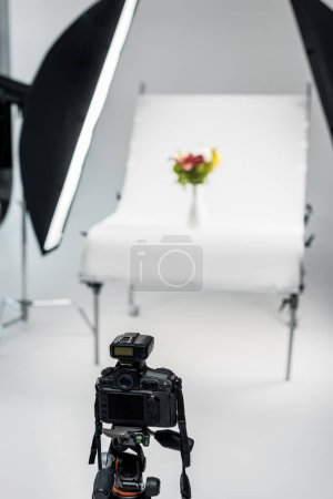 close-up view of photo camera in professional photo studio