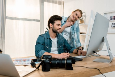 Photo for Smiling young professional retouchers working together in office - Royalty Free Image