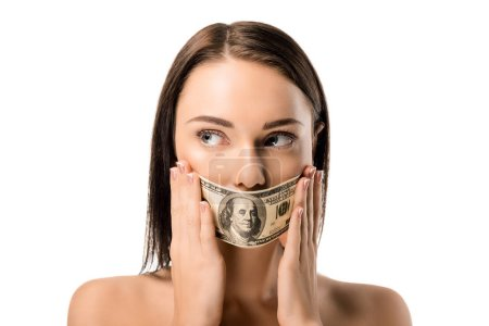 young naked woman with dollar banknote on mouth looking away isolated on white