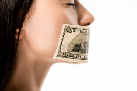 cropped shot of woman with dollar banknote on mouth and closed eyes isolated on white