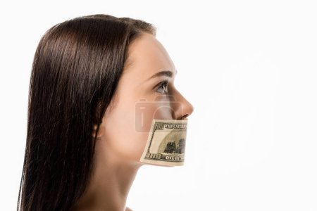 side view of woman with dollar banknote on mouth looking away isolated on white