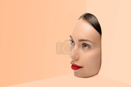 Photo for Face of attractive young woman looking away on beige background - Royalty Free Image
