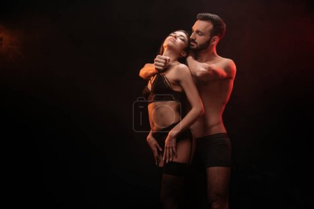 sexuality passionate couple hugging isolated on black