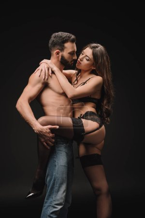 erotic couple hugging isolated on black