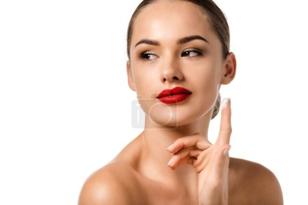 beautiful girl with red lips applying cream on face isolated on white