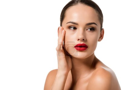 attractive girl with red lips touching face isolated on white