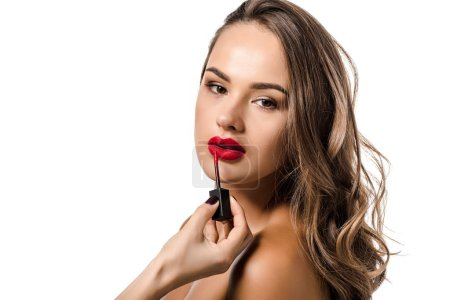 cropped view of woman making up lips of beautiful girl isolated on white