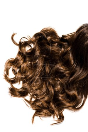 Photo for Cropped view of long curly brown female hair isolated on white - Royalty Free Image