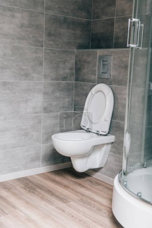 interior of modern bathroom with white ceramic toilet
