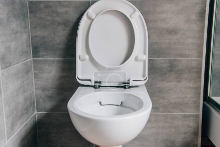 close up view of white ceramic toilet in modern bathroom