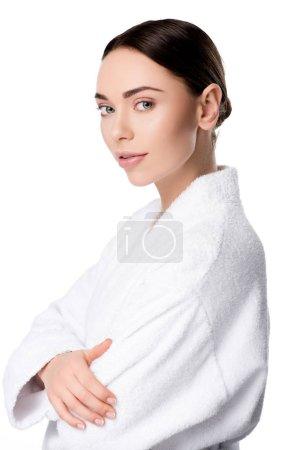 Photo pour Belle femme en peignoir regardant caméra isolé sur blanc - image libre de droit