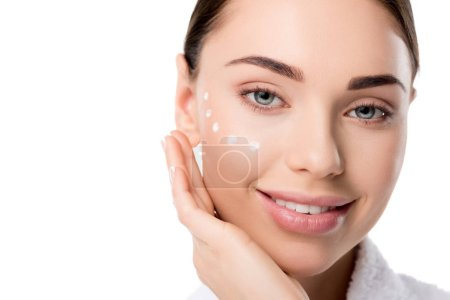 close up of beautiful woman with eye cream on face isolated on white