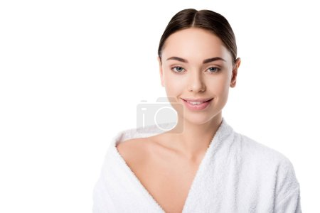 Photo for Attractive smiling woman in bathrobe looking at camera isolated on white - Royalty Free Image