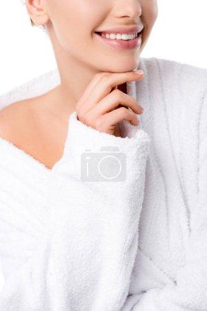 Photo pour Vue recadrée de la femme en peignoir touchant menton isolé sur blanc - image libre de droit