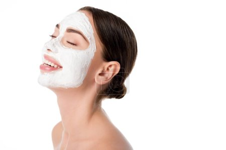 smiling woman with facial skin care mask and eyes closed isolated on white