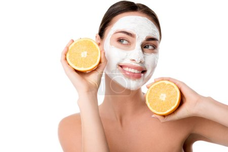 beautiful smiling woman with facial skin care mask holding oranges isolated on white