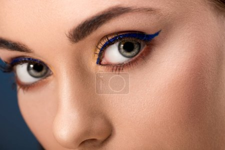 Photo for Cropped view of female eyes with blue eyeliner and perfect skin - Royalty Free Image