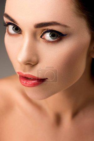selective focus of beautiful woman with glamorous makeup looking at camera