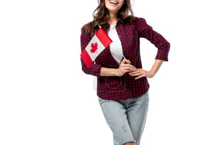 cropped view of woman with hand on hip holding canadian flag isolated on white