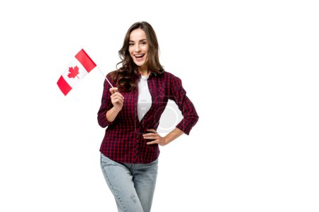 beautiful woman holding canadian flag and looking at camera isolated on white
