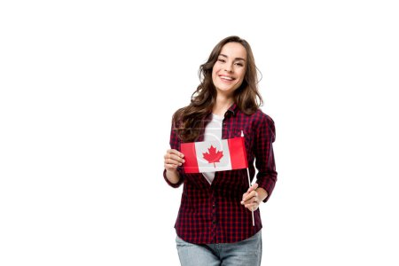 beautiful smiling woman holding canadian flag and looking at camera isolated on white