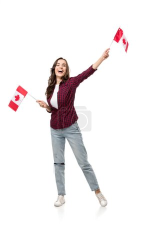 cheerful woman holding canadian flags isolated on white