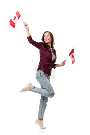 beautiful happy woman holding canadian flags isolated on white