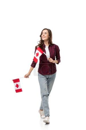 Photo pour Belle femme tenant les drapeaux canadiens isolés sur blanc - image libre de droit
