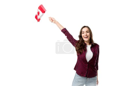 woman holding canadian flags, looking at camera and cheering isolated on white