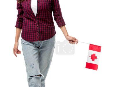 Photo pour Vue partielle de la femme tenant le drapeau canadien isolé sur blanc - image libre de droit