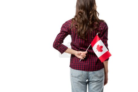 back view of woman holding canadian flag isolated on white