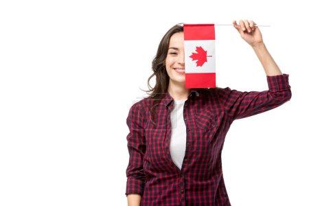 Photo pour Femme souriante tenant un drapeau canadien devant visage isolé sur blanc - image libre de droit