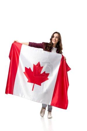 Photo pour Belle femme tenant le drapeau canadien et regardant la caméra isolé sur blanc - image libre de droit